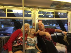 Max with grandma and grandpa (on the bus to Epcot)