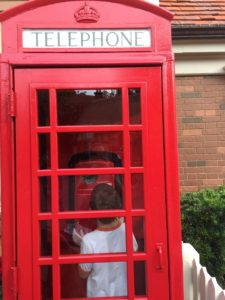 Max in a phone booth. Sadly they didn't have a police box.
